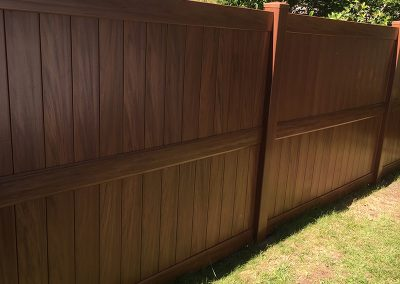 redwood look pvc fence