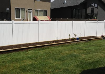 pvc fence with flower bed