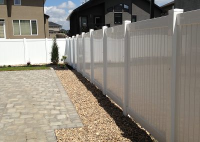 pvc fence with stone landscaping