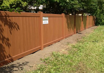 beautiful wood look pvc fence