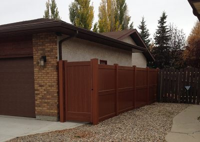 new dark wood look pvc fence