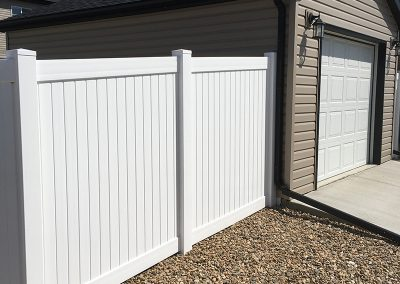 backyard pvc fence attached to garage